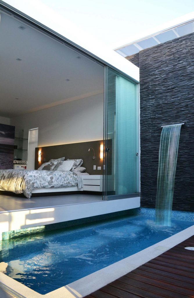 bed room with a swimming pool Simphome com