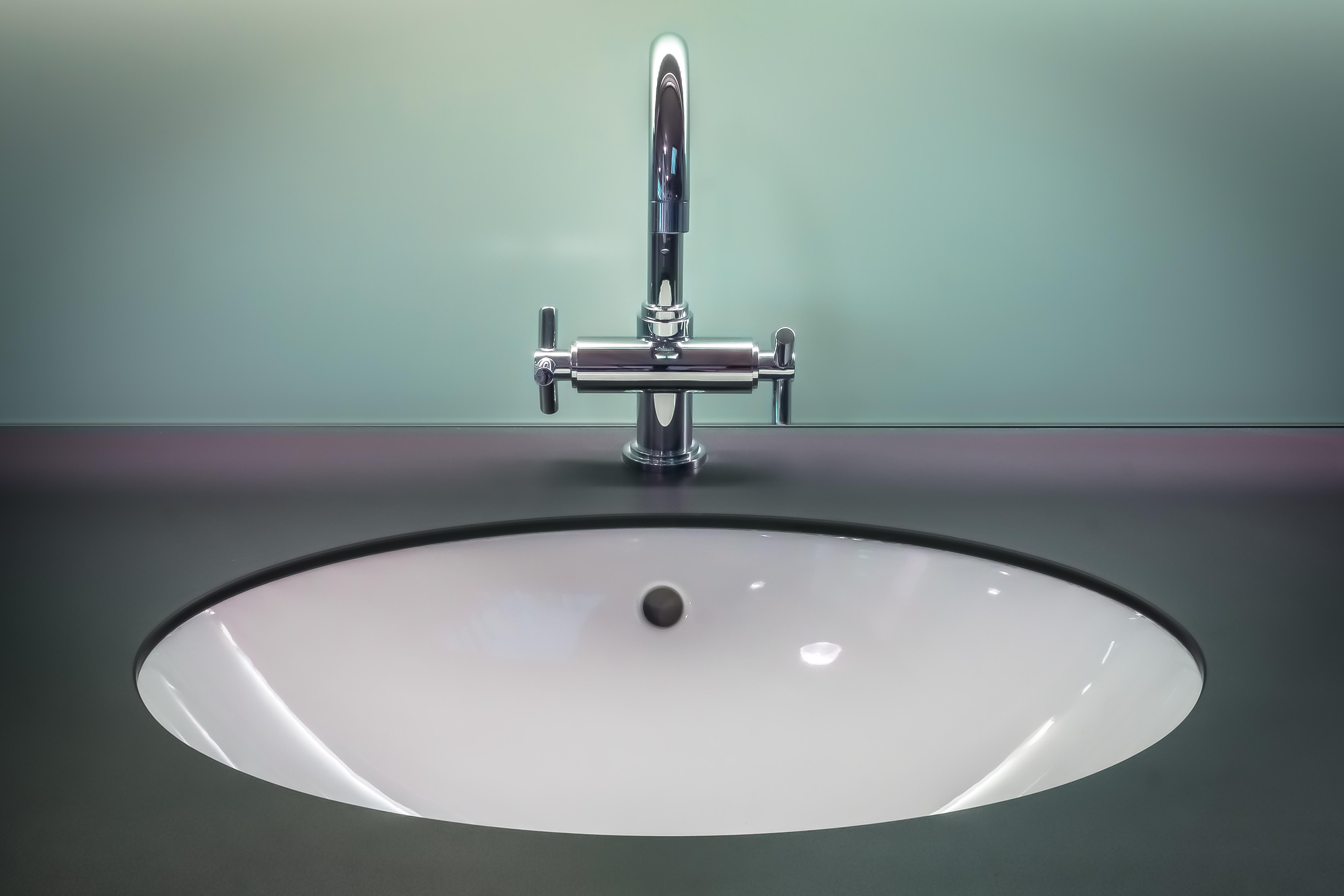 clean sink room lighting modern stainless steel bathtub bathroom indoors tap faucet bidet plumbing fixture vanity top Simphome com