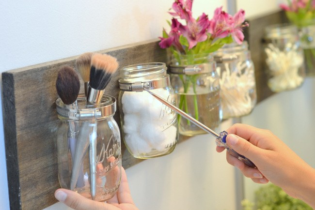 Use mason jars as wall storage units