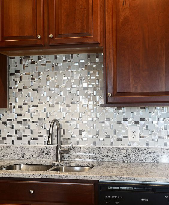 21.Naturally water-resistant, glass and metal backsplash