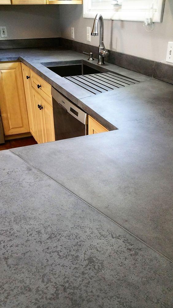 96 Interesting use of seams in this medium grey concrete countertop via Simphome