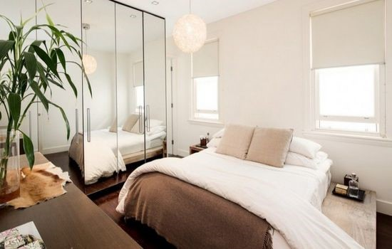 10 Enlarge Your Bedroom with Mirrors via simphome