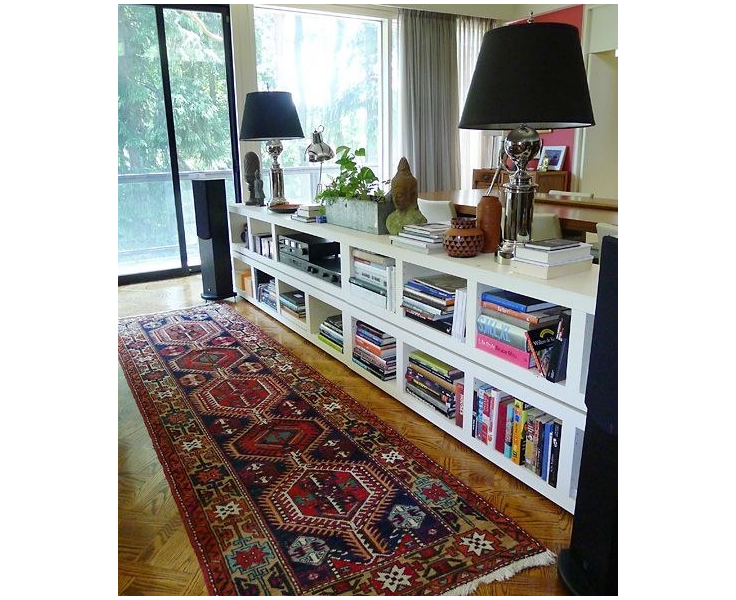 12 Stack Lack bookcases behind a couch to visually divide your space while also providing tons of storage via simphome 1