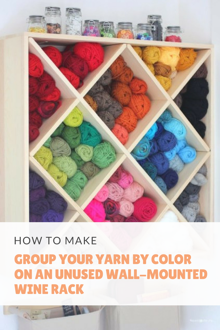 27 Group your yarn by color on an unused wall mounted wine rack via simphome