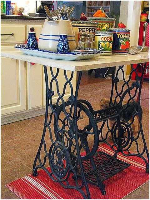 2. A Kitchen Island from an Old Sewing Machine via Simphome.com