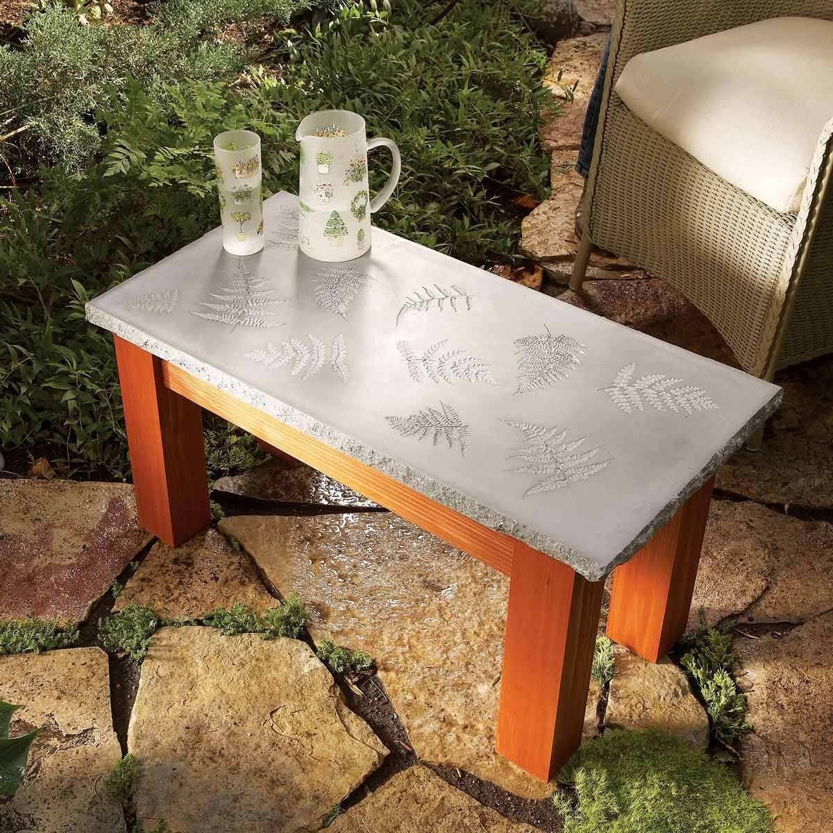 10. Artistic Concrete Coffee Table via Simphome