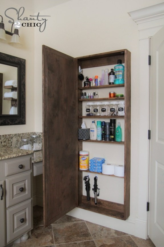 5. Bathroom Storage with a Large Mirror via Simphome