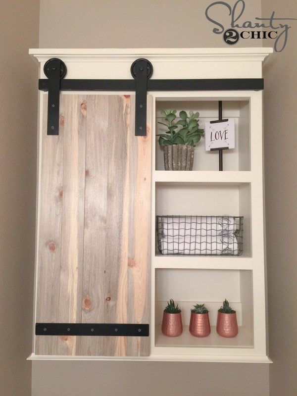 9. Farmhouse Style Bathroom Cabinet via Simphome
