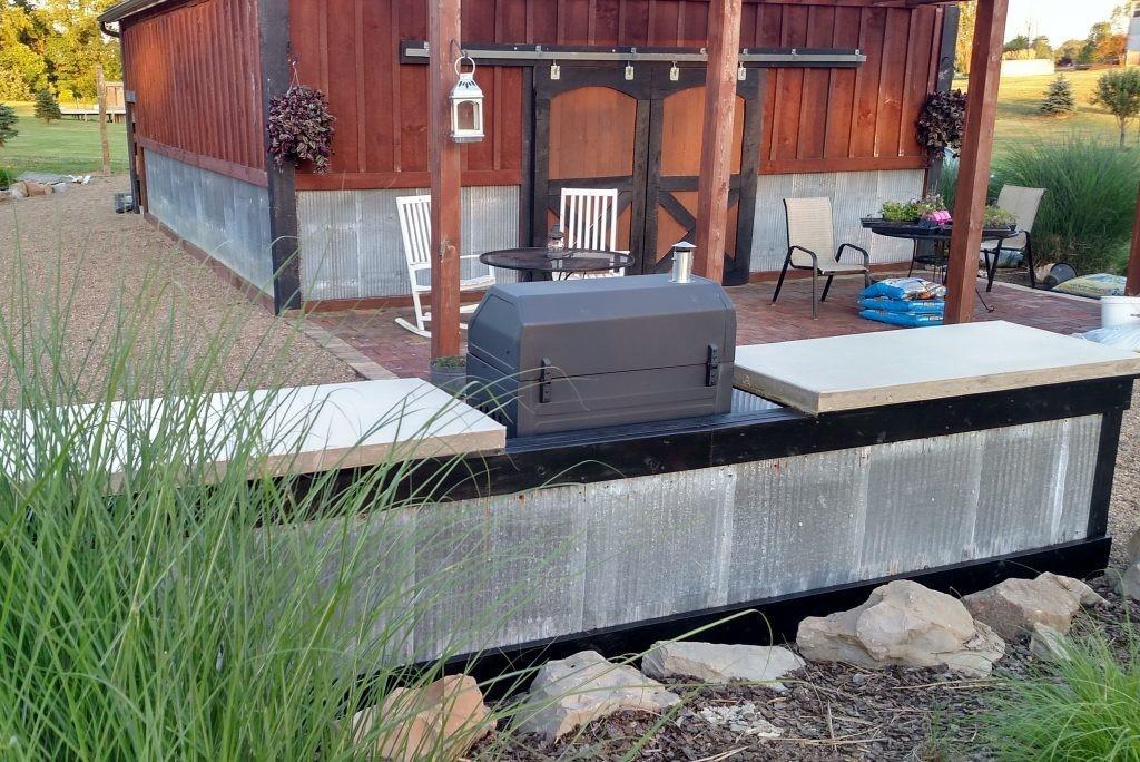 1. Outdoor Kitchen with Concrete Countertop via Simphome