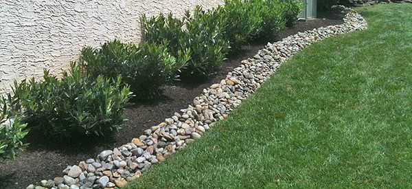 10. Landscape Edging with Stone via Simphome