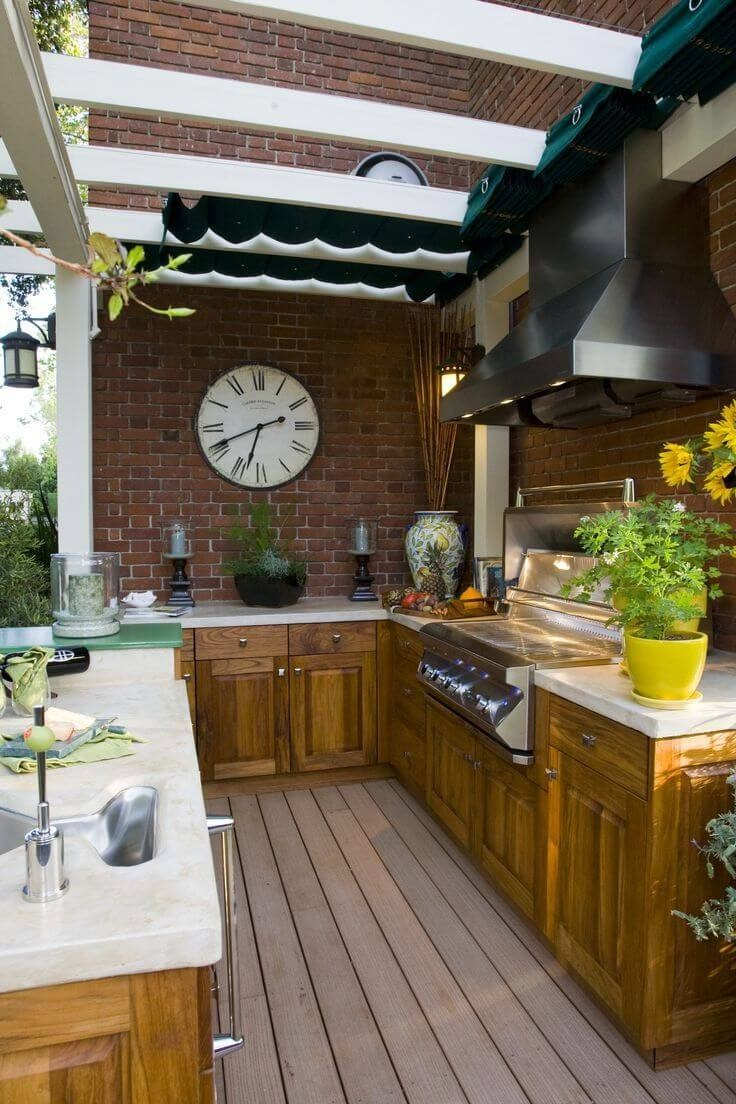 2. Outdoor Kitchen with Retractable Patio Cover via Simphome