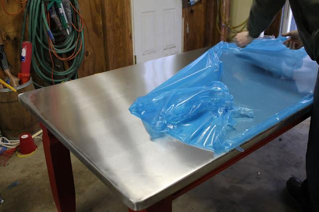 4. Dining Table with Zinc Sheet Metal Top via Simphome 2