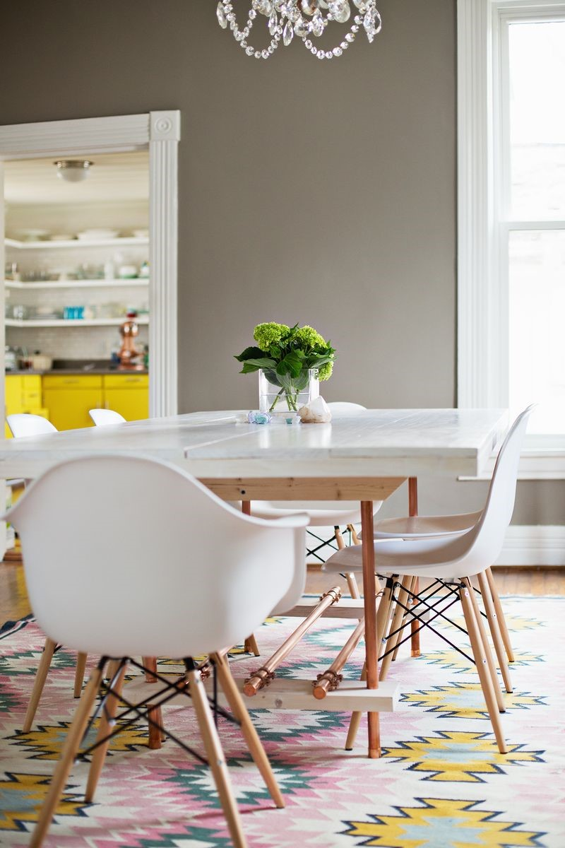 4. White Table with Copper Legs via Simphome