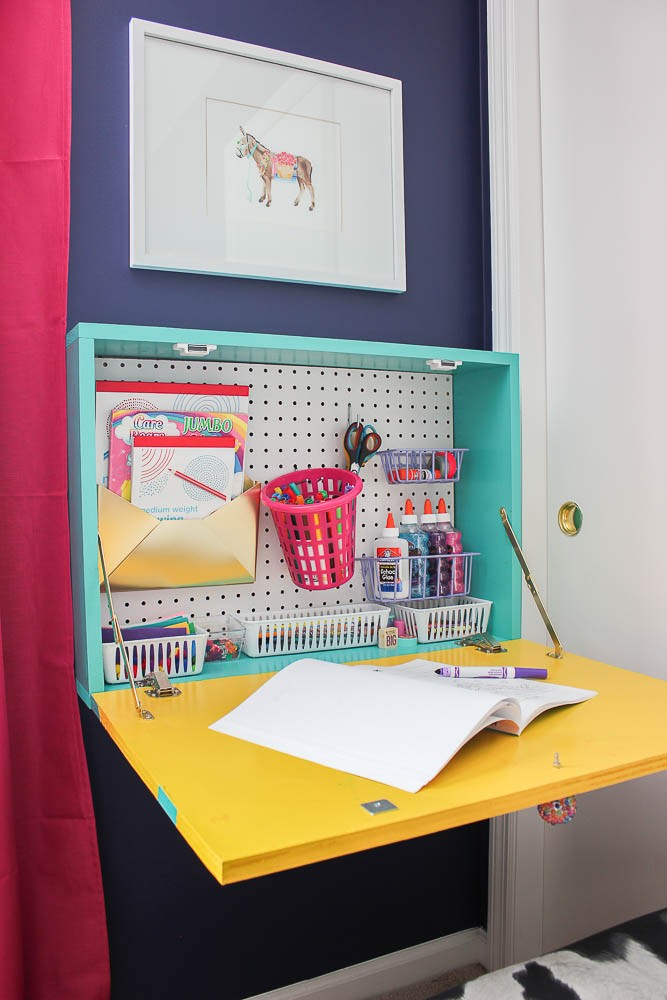 7. Wall Mounted Drop Down Desk with Pegboard via Simphome