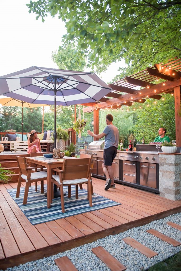 9. Striking Outdoor Kitchen with Pergola via Simphome
