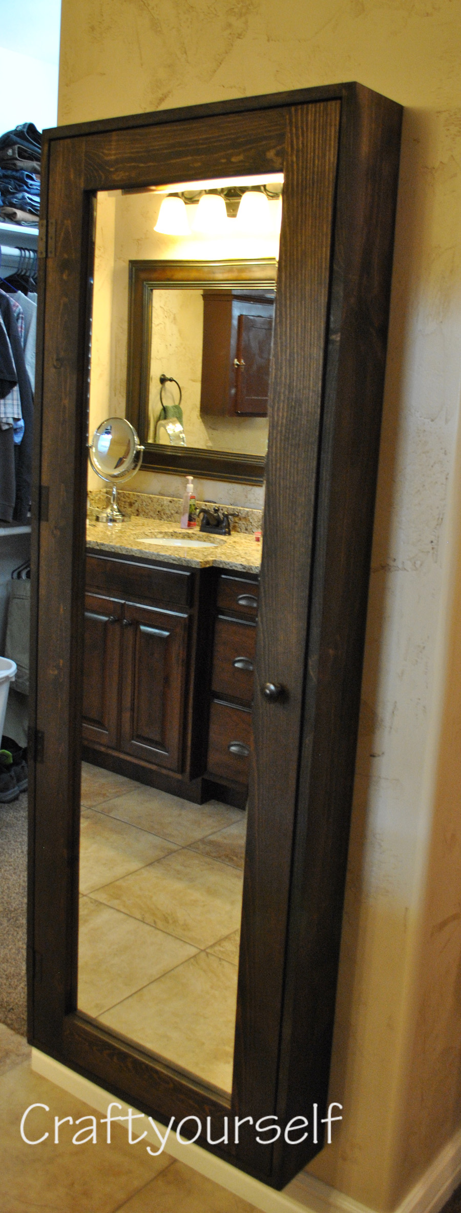 1. Bathroom Cabinet with Mirror via SIMPHOME.COM
