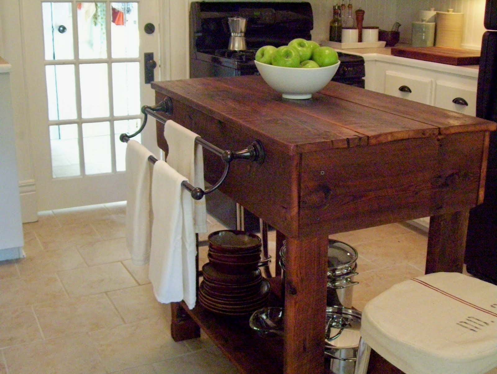 10. Rustic Kitchen Island with Towel Holder via Simphome