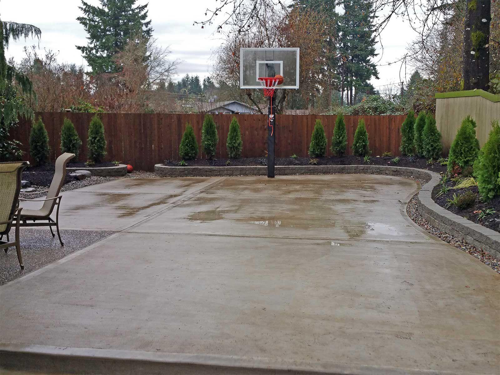 5. Concrete backyard basketball court via Simphome.com