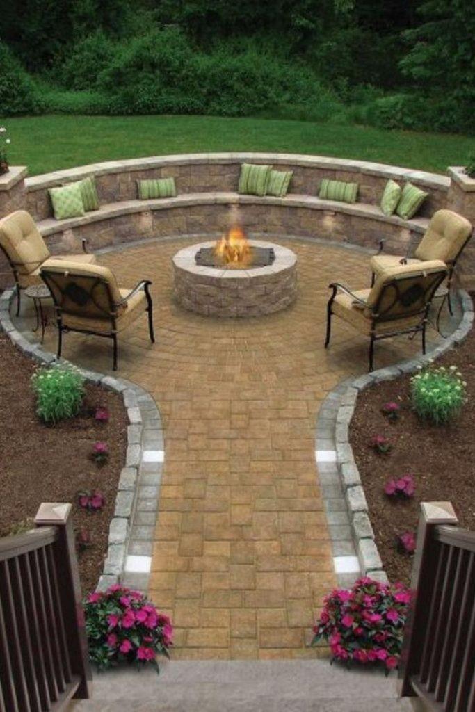 5.Luxurious Classic Backyard Idea with a Round Firepit via Simphome.com