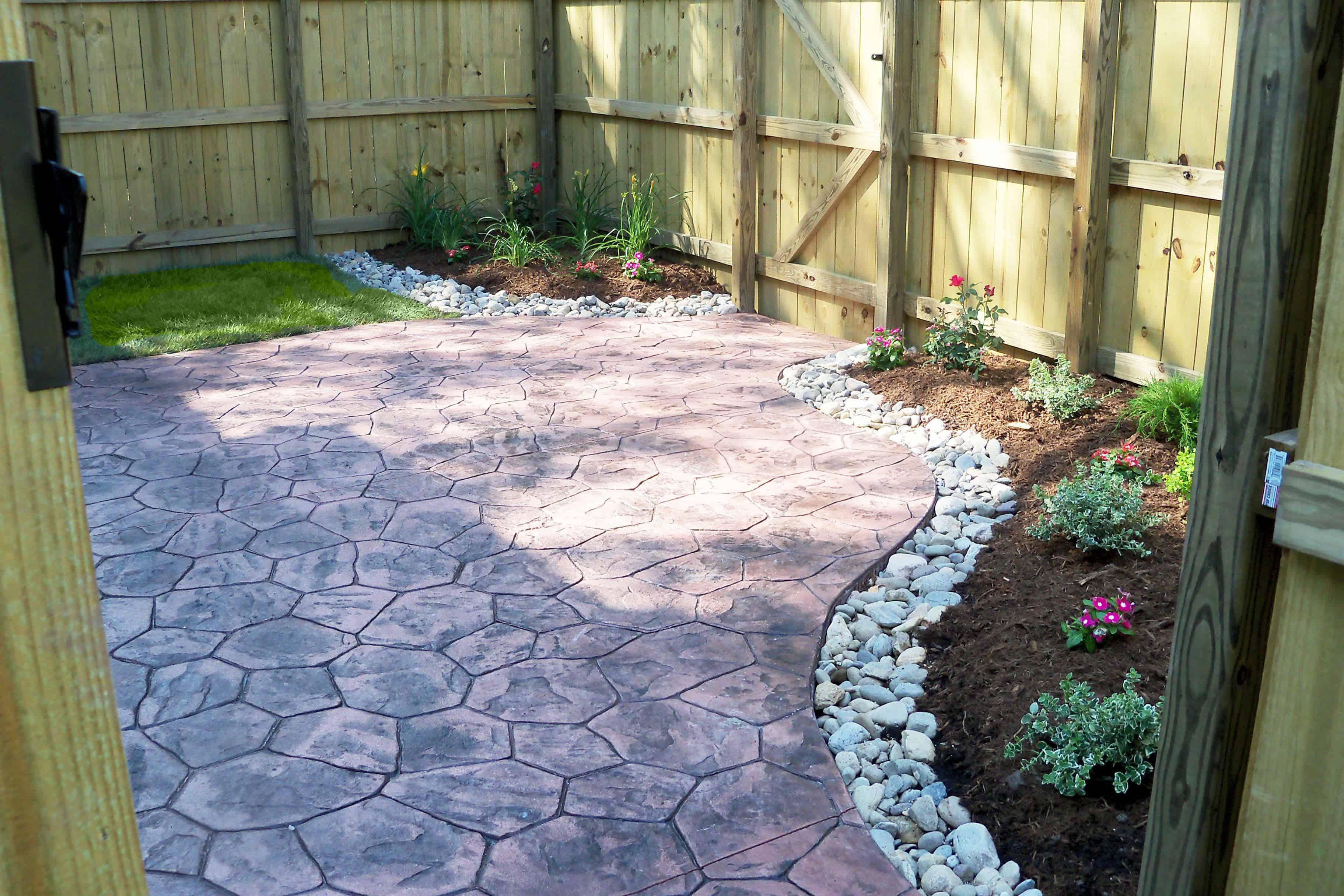 8. Use colorful Random stamped concrete for small backyard via Simphome.com