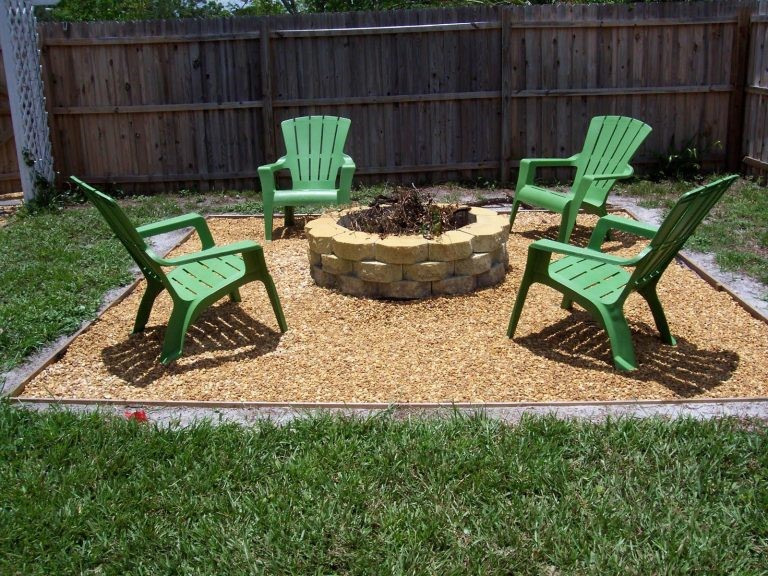 9.Livelier Firepit Area with the Creamy Colored Application and Green Chairs via Simphome.com
