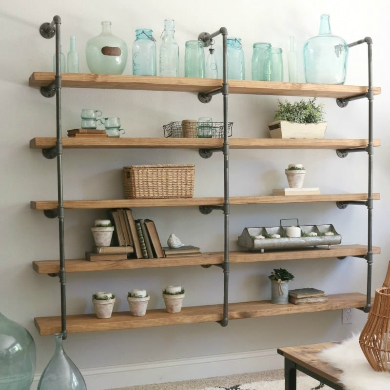10. SIMPHOME.COM Simple Pipe Shelving Idea to Display Your Treasures