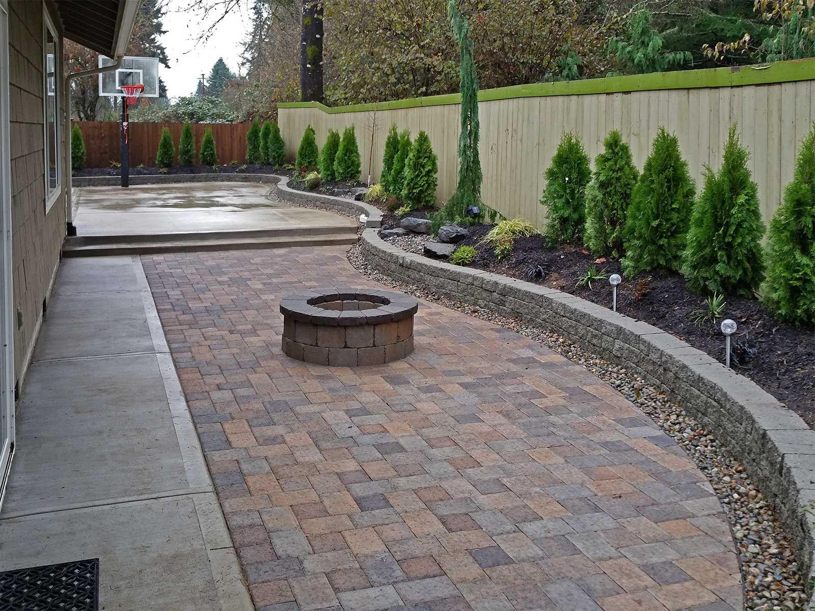 14.SIMPHOME.COM backyard paver patio connected to a concrete slab basketball court