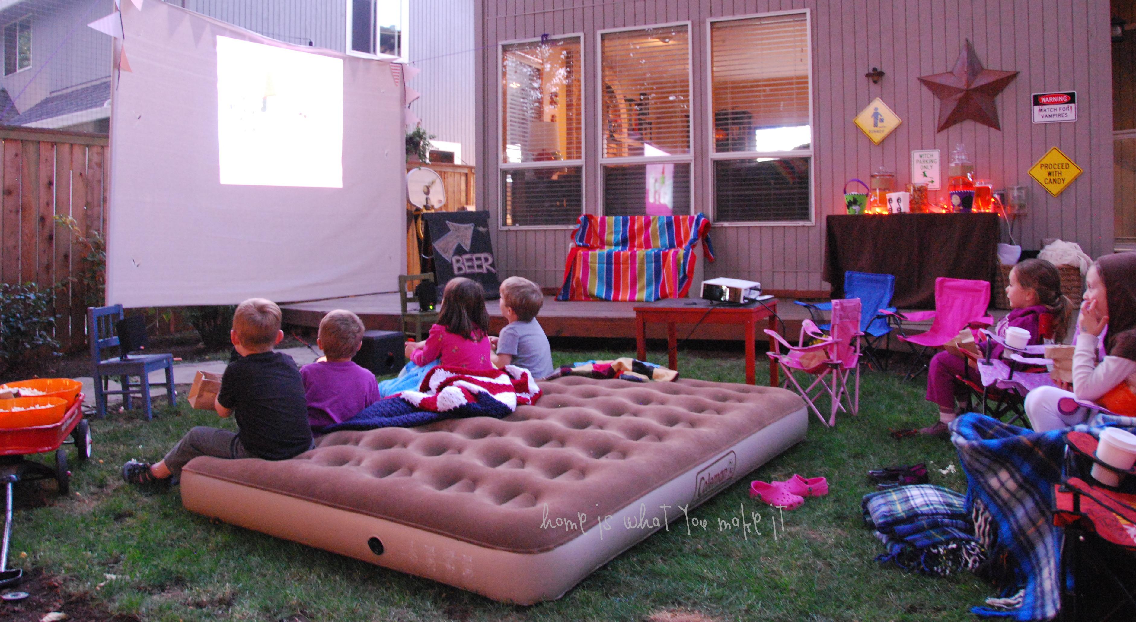 19.SIMPHOME.COM fall backyard movie night home