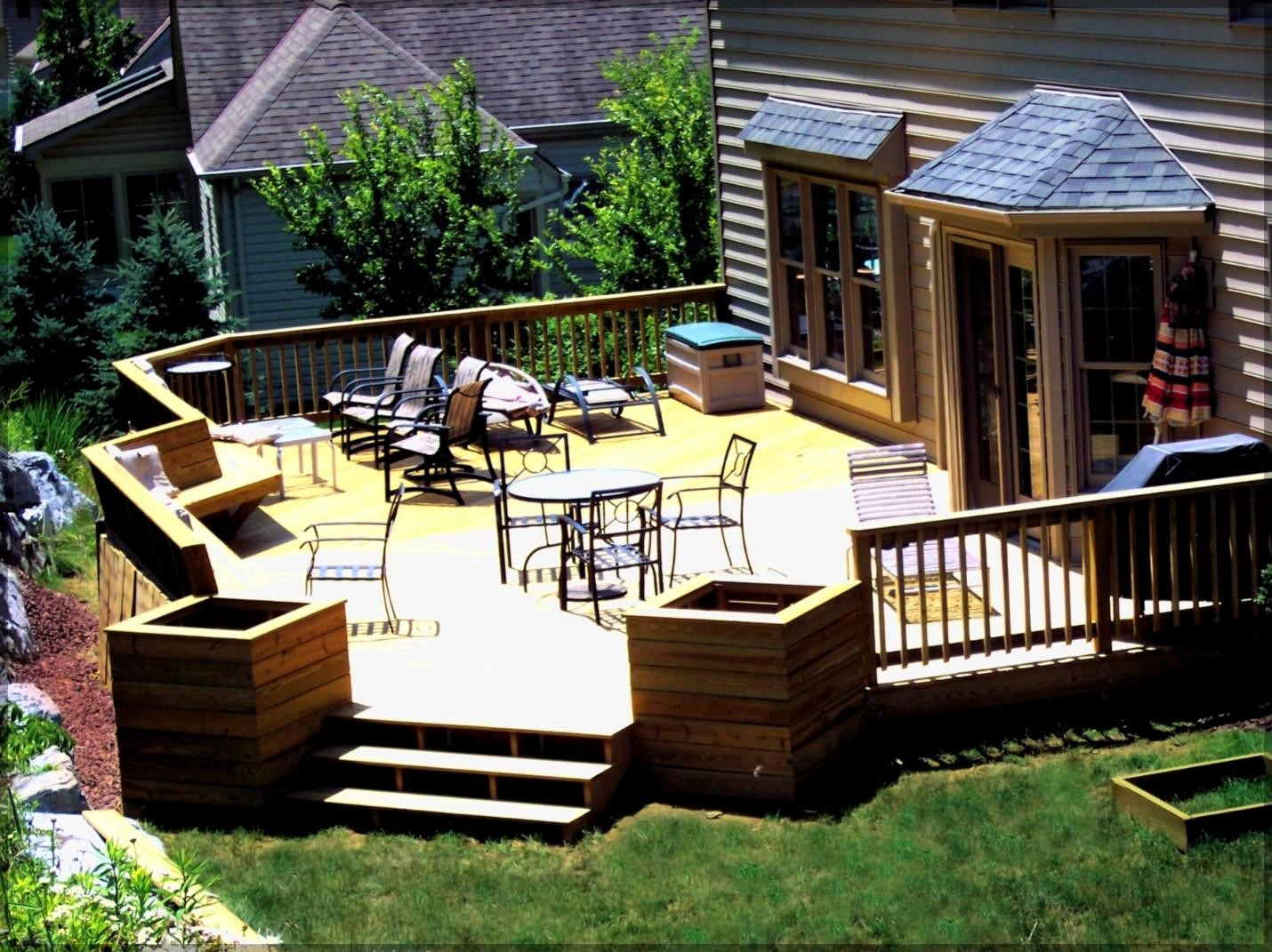 3.SIMPHOME.COM Backyard Patio with Wooden Deck