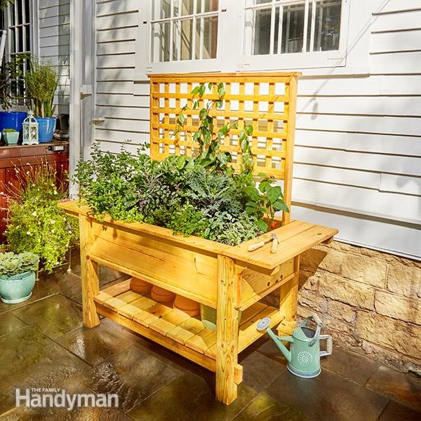 4.SIMPHOME.COM 10 DIY Outdoor Wood Projects Raised Patio Planter