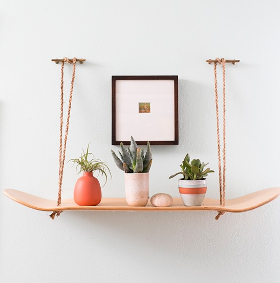 8. Skateboard Shelf with Rope via SIMPHOME.COM
