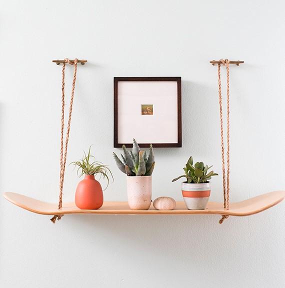 8. Skateboard Shelf with Rope via SIMPHOME.COM
