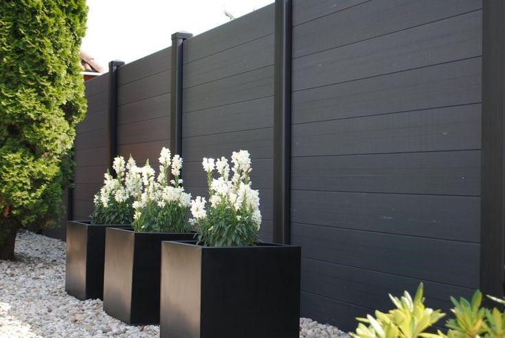 SIMPHOME.COM 10 Tricks How to Upgrade Wood Fence Ideas for Backyard 7.Black Wooden Fence for a Classy and Modern Vibe