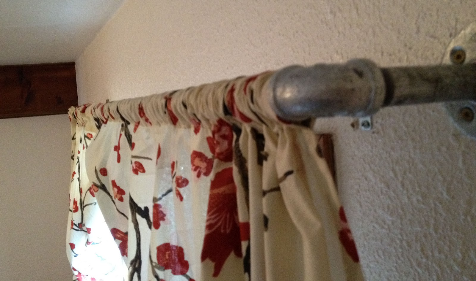 8. SIMPHOME.COM An Industrial Pipe Curtain Rod