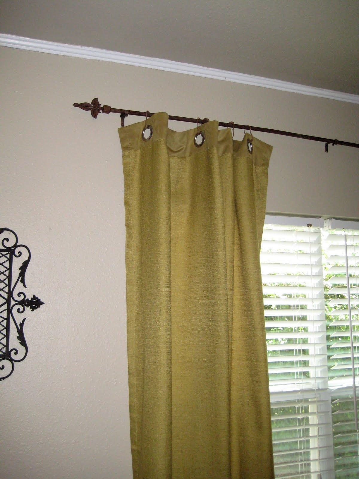 9.SIMPHOME.COM A Welded Fence Rail Curtain Rod Project Idea