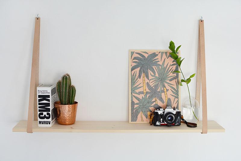 9.Horizontal burkatron diy leather strap shelf via Simphome.com