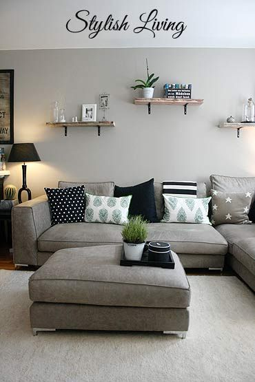2.A Grey Couch and Plush Ottoman for a Tunnel Like Living Room via Simphome.com