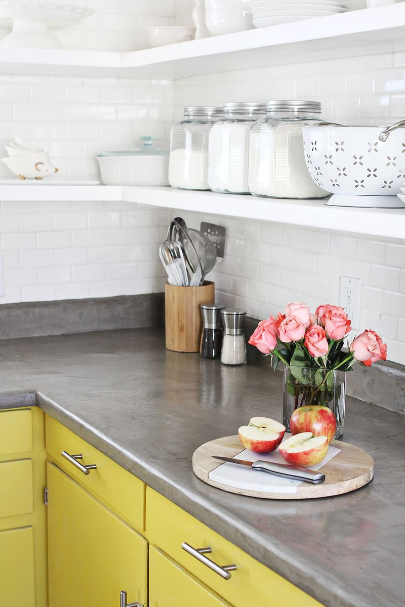 7.Add strength and elegance to your countertop with concrete via Simphome.com