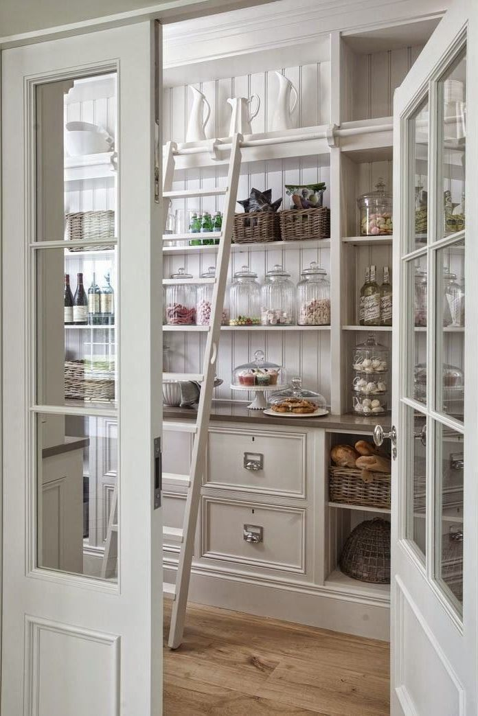 6. Dedicate a new pantry space to build a walk in pantry complete with a ladder and special door by simphome.com