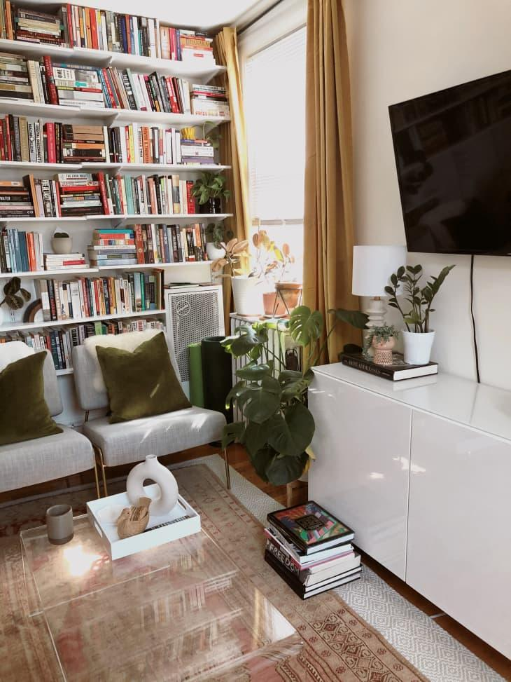 7. Smart Shelving Tricks That Will Fake a Built In Library Look in Your Living Room by simphome.com