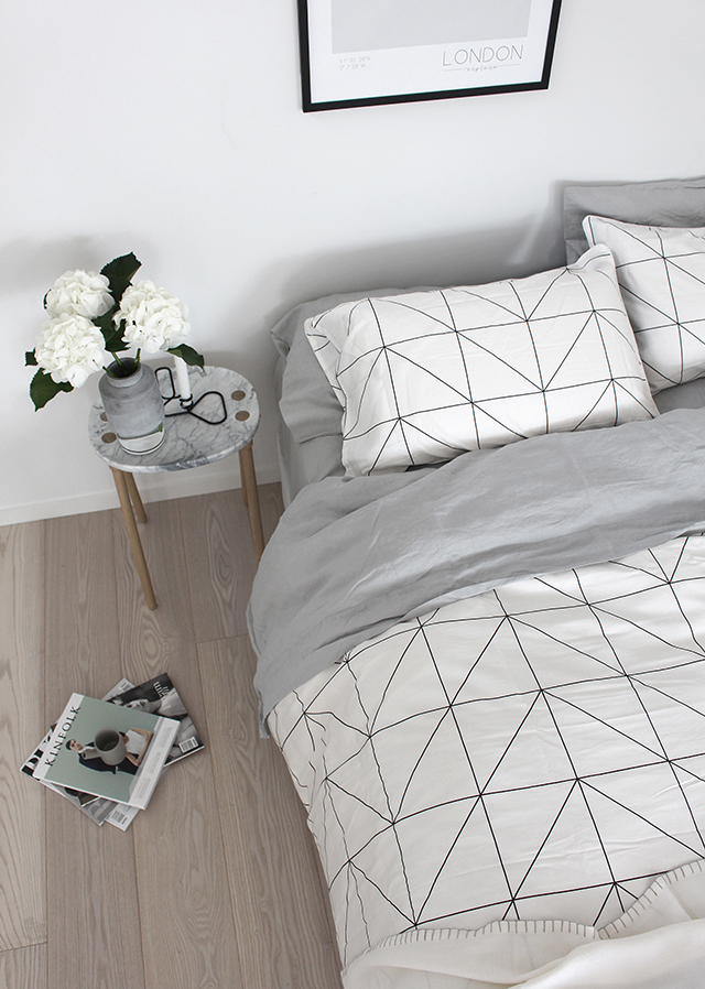 8. Opt For Geometric Bedding In A Light Color To Brighten Your Bedroom And Make It Feel Larger by simphome.com