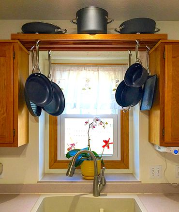 9. Hanging Pot Rack by simphome.com .
