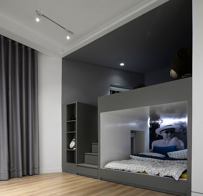 7. Built In Bunk Beds and Closets Make Space For a Play Area In This Kids Bedroom by simphome.com