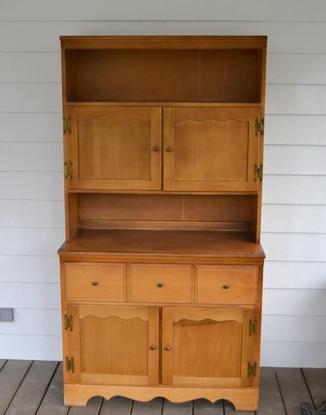 2. Turn An Old Hutch Into A Dropzone for a Mudroom by simphome.com