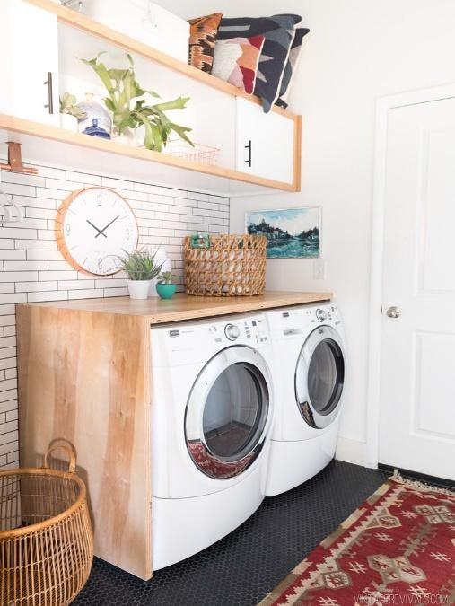 7. Subway Tile Backsplash Accent Laundry Room by simphome.com