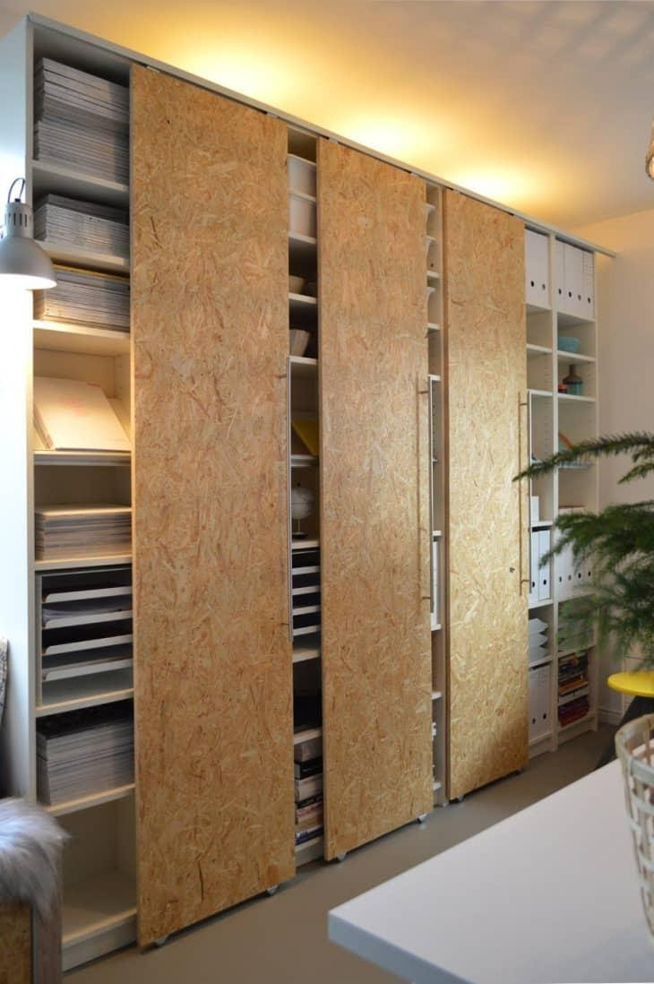 5. Give IKEA BILLY Bookcases a new sliding door by simphome.com .