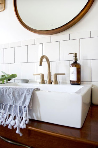 5. stylish and funtional fixtures in a modern vintage bathroom by simphome.com