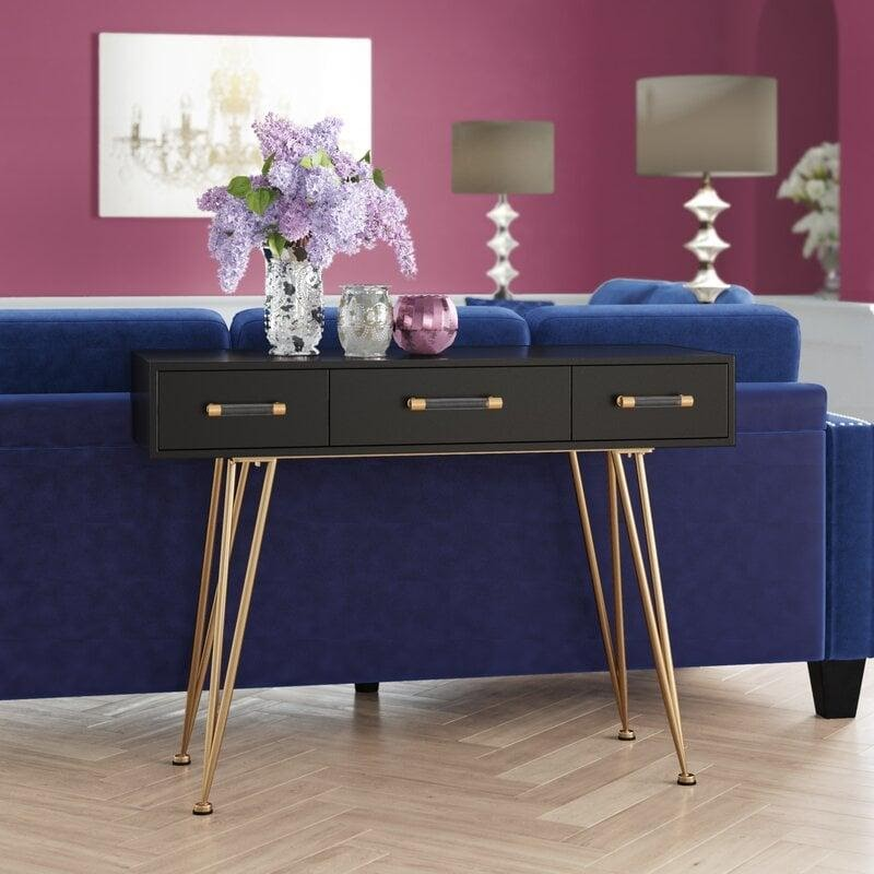 1. Anchor It with a Console Table by simphome.com