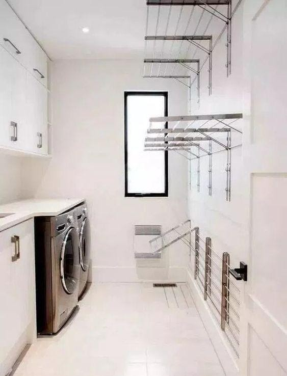 8. The Long and Narrow Laundry Room by simphome.com